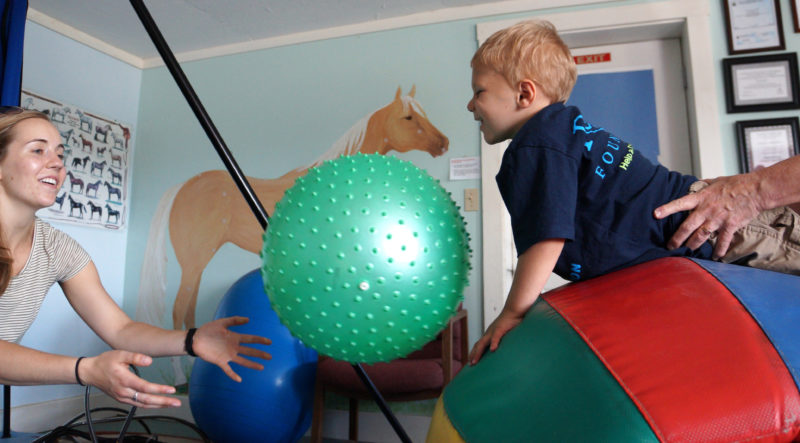 photo of therapy student on a ball