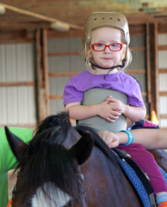 photo of a hippotherapy student on a horse
