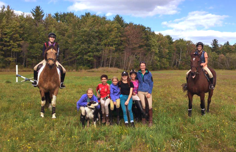 group photo of Pony Club members in a field
