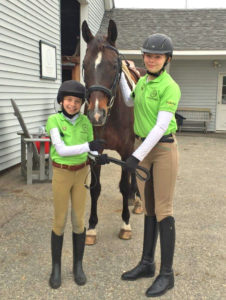 photo of 2 Pony Club members with a horse