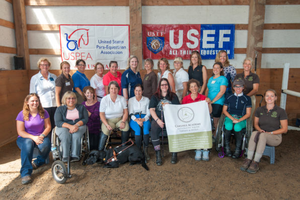 Photo of instructors and students at a para-equestrian training clinic