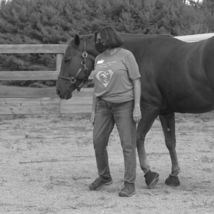 Health care worker interacting with a horse.
