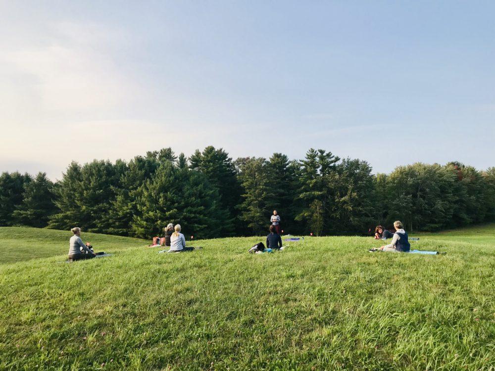 Yoga retreat in the field photo