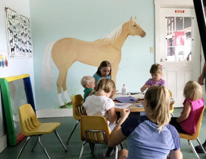 children sitting around a table labeling horse parts